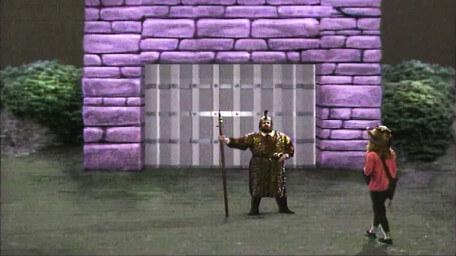 The gatekeeper, as played by Michael Cule in Series 5 of Knightmare (1991).