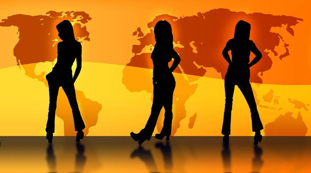 Silhouettes of girls in front of a world map