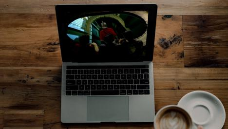 Watching Knightmare clips on a laptop with coffee. Adapted from photo by Nathan Ansell on Unsplash.
