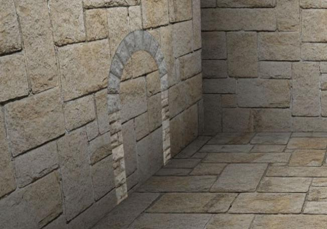 An archway is slotted into the wall of Alex Fruen's dungeon room.
