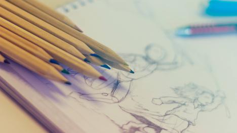 Coloured pencil set and partially completed drawing.
