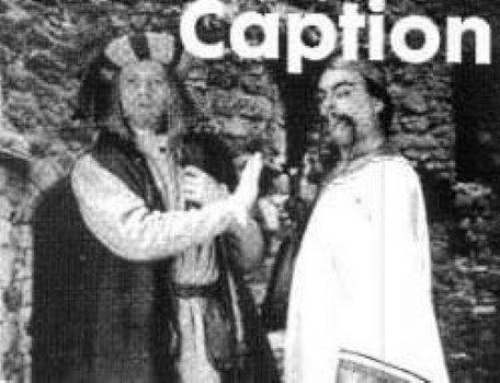 A caption competition image featuring Ah Wok and Julius Scaramonger in The Quest, the Official Newsletter of the Knightmare Adventurers' Club. Volume 2, Issue 1.