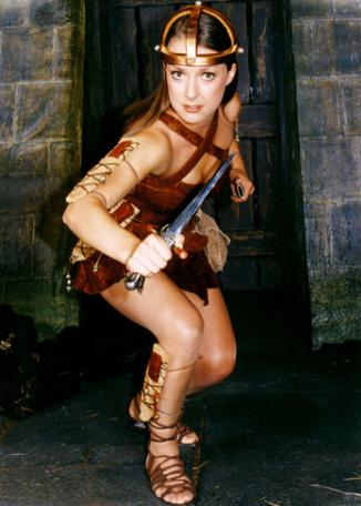 Stiletta (Joanne Heywood) poses with a knife in a promotional shot for Series 8 of Knightmare.