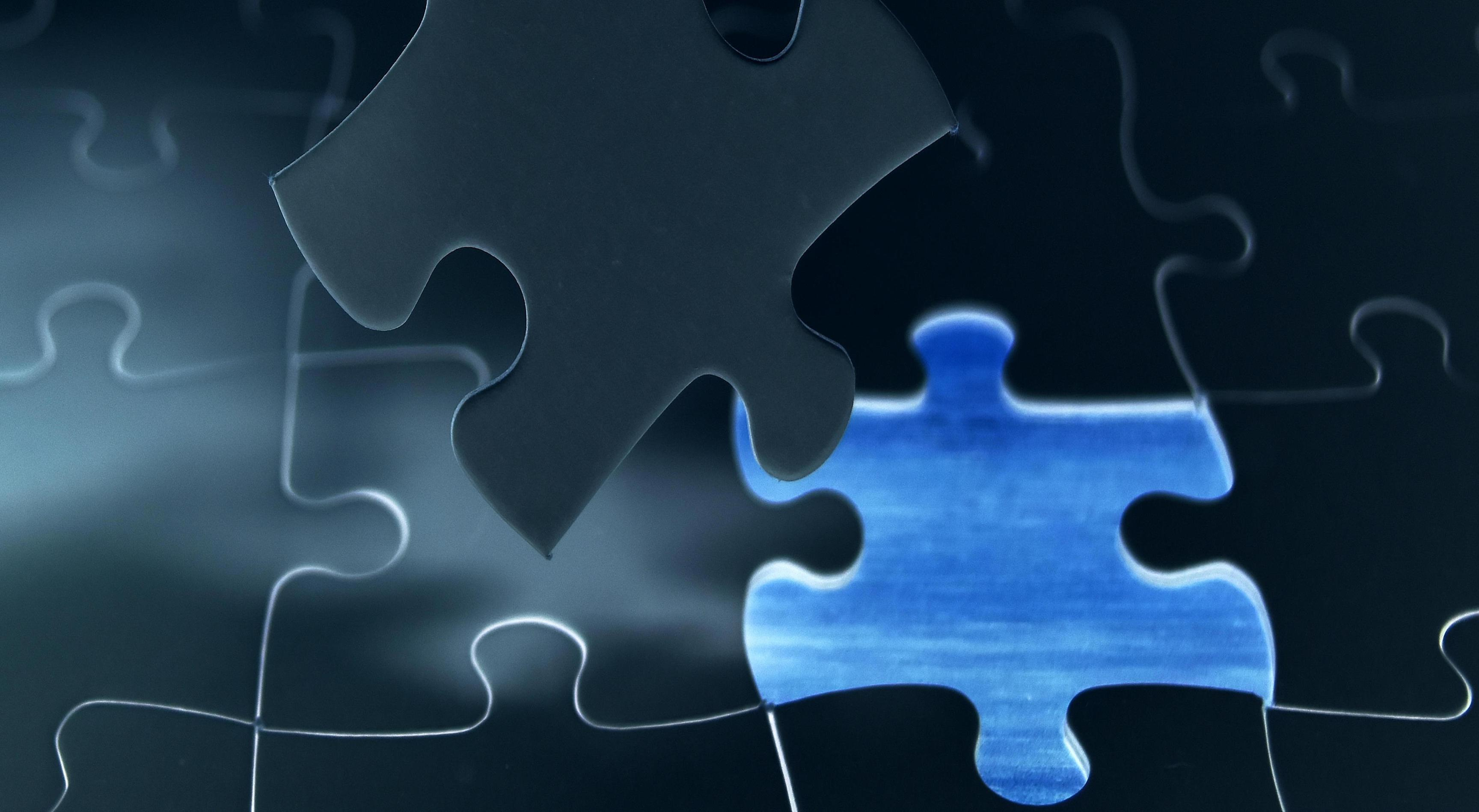 A piece being inserted into a jigsaw puzzle