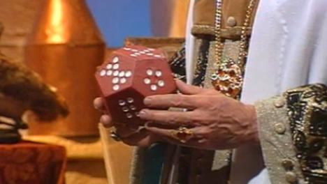 The magician holds a dice in El Rescate del Talisman.