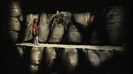 The ledge, based on a handpainted scene by David Rowe, as shown on Series 2 of Knightmare (1988).