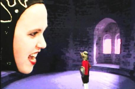 Knightmare Series 4 Quest 6. The face of Malice appears large in a circular chamber.