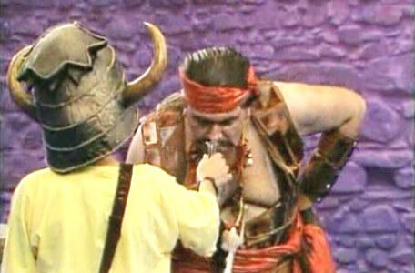 Knightmare Series 4 Quest 8. Giles holds out a sniff bottle to Fatilla the Hun.