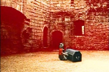 Knightmare Series 5 Team 8. Duncan unlocks a chest in a courtyard.