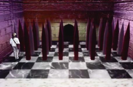 Knightmare Series 7 Team 2. Nicola on a chess board covered by spikes.