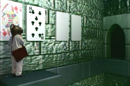 Knightmare Series 8 Team 3. Nathan on a ledge with two playing cards on the wall to choose from.