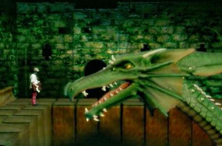 Knightmare Series 8 Team 5. Rebecca stands on a perimeter ledge in front of Smirkenorff the Dragon.