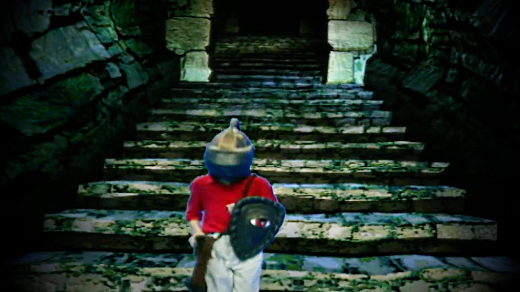 Dungeoneer walks down stairs into Level 3 in Series 8 of Knightmare (1994).